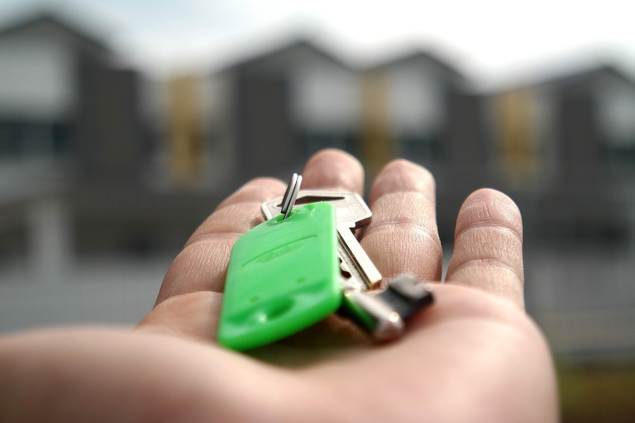 A buyer holding the key to their new home